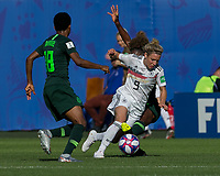 GRENOBLE, FRANCE - JUNE 22: Svenja Huth #9 of the German National Team dribbles as Francisca Ordega #17 of the Nigerian National Team successfully defends during a game between Nigeria and Germany at Stade des Alpes on June 22, 2019 in Grenoble, France.