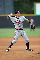Danville Braves third baseman Jake Lanning (26) warms up between innings of the game against the Burlington Royals at Burlington Athletic Park on July 12, 2015 in Burlington, North Carolina.  The Royals defeated the Braves 9-3. (Brian Westerholt/Four Seam Images)