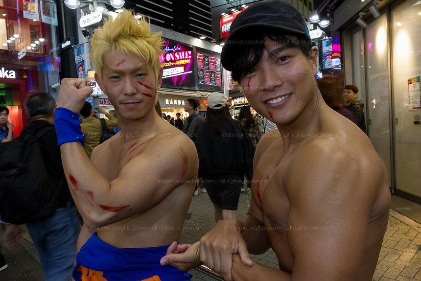 Two muscular Japanese men dressed as costumes during the Halloween celebrations Shibuya, Tokyo, Japan. Saturday October 27th 2018