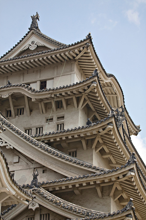 main donjon; Daitenshu; Himeji Castle; The White Heron; castle architecture architectural history historical building roof tiles pattern landmark [UNESCO World Heritage Site] [Himeji Japan] Hyogo Prefecture [Colleen Miniuk-Sperry] color vertical