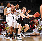 SIOUX FALLS, SD - MARCH 6:  Mikaela Shaw #22 passes the ball as IUPUI defenders, including Shaquira Scott #25 and Martha Burse, look on in the 2016 Summit League Trounament.  (Photo by Dick Carlson/Inertia)