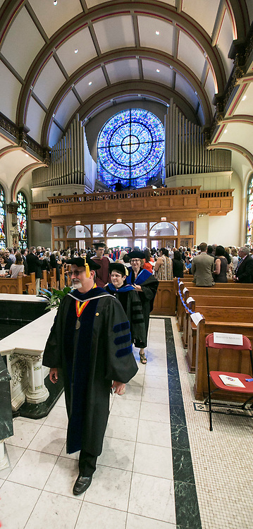 Faculty members make their way into the Saint Vincent de Paul Parish Church on DePaul University's Lincoln Park Campus for the annual Baccalaureate Mass Friday, June 9, 2017. The event was part of the 119th commencement ceremonies for the Chicago university. (DePaul University/Jamie Moncrief)
