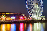 Seattle, Washington<br /> Seattle Great Wheel, a Ferris wheel on the Elliott Bay waterfront - Pier 57, at night