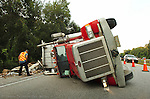 10/5/09--Tampa, FL.--A semi-tractor trailer overturned on Interstate 275 northbound, 2 miles South of Interstate 75 earlier this morning. Staff photo by Jay Nolan.