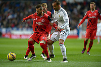 MADRID - ESPAÑA - 04-2-2015: Jese (Der.) jugador de Real Madrid, disputa el balon con Tremoulinas (Izq.) jugador del Sevilla durante partido de La Liga de BBVA de España, 2015 Real Madrid  y Sevilla en el estadio Santiago Bernabeu de la ciudad de Madrid.  / Jese (R) player of Real Madrid vies for the ball with Tremoulinas  (L) player of Sevilla, during a match between Real Madrid and Sevilla for the La Liga de BBVA de España 2015 in the Santiago Bernabeu stadium in Madrid.  Photo: Asnerp / Patricio Realpe / VizzorImage.