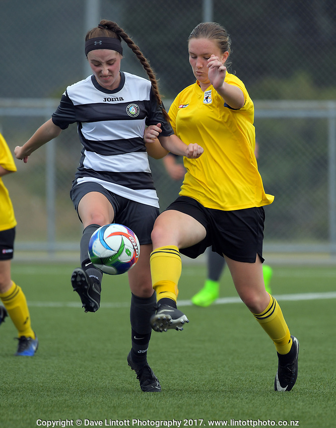 Action from the New Zealand Age Group Championships Under-16 Girls match between Capital (yellow tops) and Northern at Memorial Park in Petone, Wellington, New Zealand on Wednesday, 13 December 2017. Photo: Dave Lintott / lintottphoto.co.nz