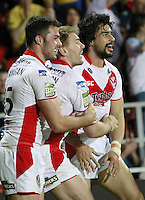 PICTURE BY CHRIS MANGNALL /SWPIX.COM...Rugby League - Super League  - St Helens Saints v Leeds Rhinos  - Langtree Park, St Helens, England  - 25/03/12... St Helens  Mark Flanagan (l) and Michael Shenton (c) congratulate try Scorer Ade Gardner