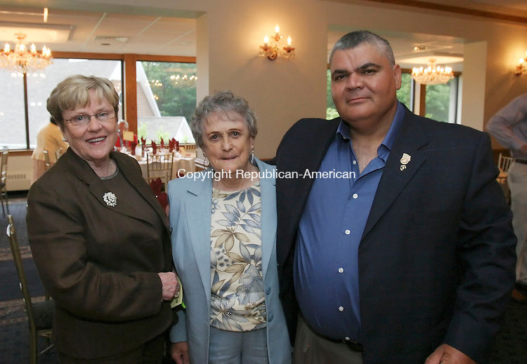 WOLCOTT, CT 6/28/07- 062807BZ10- From left- Patty Mulhall, Democratic Registrar of Voters in Waterbury, Betty Griffin, of the citizens service center of Waterbury, and Mike Rinaldi, of the Marine Corps League,<br /> <br /> during the 3rd Annual Blessed Sacrament Waterbury Butterfly Award Dinner at Mahan's lakeview Fine Catering in Wolcott Thursday night. <br /> Jamison C. Bazinet Republican-American