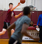 WATERBURY, CT-120618JS12-Sacred Heart's Connor Tierney dishes off the ball while running drills during practice Thursday at Alumni Hall. <br /> Jim Shannon Republican American
