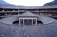 Traditional Hakka roundhouse, with clan temple at its' centre. These fort-like structures are home to dozens of families, and are often several hundreds of years old  in Fujian, China..