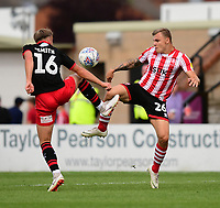 Lincoln City's Harry Anderson vies for possession with Swindon Town's Martin Smith<br /> <br /> Photographer Chris Vaughan/CameraSport<br /> <br /> The EFL Sky Bet League Two - Lincoln City v Swindon Town - Saturday 11th August 2018 - Sincil Bank - Lincoln<br /> <br /> World Copyright &copy; 2018 CameraSport. All rights reserved. 43 Linden Ave. Countesthorpe. Leicester. England. LE8 5PG - Tel: +44 (0) 116 277 4147 - admin@camerasport.com - www.camerasport.com