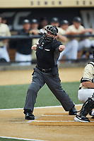 Home plate umpire Jonathan Merry calls a batter out on strikes during the ACC baseball game between the Miami Hurricanes and the Wake Forest Demon Deacons at David F. Couch Ballpark on May 11, 2019 in  Winston-Salem, North Carolina. The Hurricanes defeated the Demon Deacons 8-4. (Brian Westerholt/Four Seam Images)