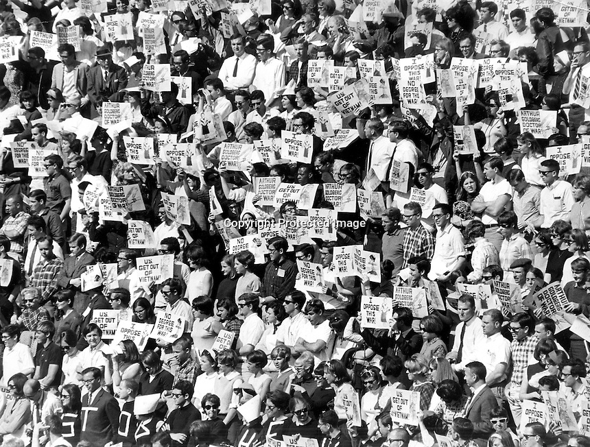 Charter Day at U.C. Berkeley 1966 . Students at the Greek Theater holding signs protesting the Viet Nam War. .(photo copyright 1966 Ron Riesterer/Oakland Tribune)