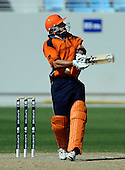 Afghanistan V Netherlands - World T20 Super Four stage qualifying cricket match in Dubai Sports City Cricket Stadium - pics from second innings, Netherlands batting - a well-worked innings of 24no by Essexs' Ryan ten Doeschate, seen here taking a blow to the stomach, was enough to see the Dutch victorious, and inflict the first defeat of the tournament on Afghanistan. ten Doeschate was Man of the Match - Picture by Donald MacLeod 12.02.10