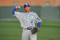 Left fielder Samir Duenez (3) of the Lexington Legends warms up before a game against the Greenville Drive on Tuesday, April 14, 2015, at Fluor Field at the West End in Greenville, South Carolina. Lexington won, 5-3. (Tom Priddy/Four Seam Images)