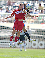 Chad Barret, left, and Ryan Cochrane, right, battle for a head ball, .Chicago Fire 1, San Jose Earthquakes 0, Saturday, April 12, 2008 at the Oakland Coliseum, Oakland, California.