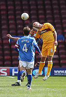 Michael Higdon (right) and Alan Maybury compete in the air as Jody Morris watches in the Motherwell v St Johnstone Clydesdale Bank Scottish Premier League match played at Fir Park, Motherwell on 28.4.12.
