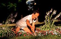 Man working in his flower garden.