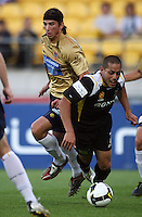 Adam Griffiths and Leo Bertos collide in the box during the A-League match between Wellington Phoenix and Newcastle Jets at Westpac Stadium, Wellington, New Zealand on Sunday, 4 January 2009. Photo: Dave Lintott / lintottphoto.co.nz