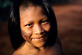 A - ukre village, Xingu Indigenous Area, Para State, Brazil. Pidjuri, a Kayapo boy with black face paint.