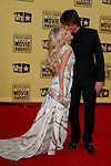 January 15, 2010:  Kristin Chenoweth and guest arrives at the 15th Annual Critics' Choice Movie Awards held at the Palladium in Los Angeles, California. .Photo by Nina Prommer/Milestone Photo