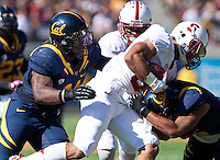 October 20th, 2012: California's Nick Forbes prepares to tackle Stanford's Kelsey Young during a game at Memorial Stadium at Berkeley, Ca   Stanford defeated California 21 - 3