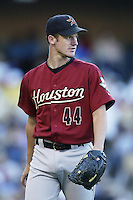 Roy Oswalt of the Houston Astros pitches during a 2002 MLB season game against the Los Angeles Dodgers at Dodger Stadium, in Los Angeles, California. (Larry Goren/Four Seam Images)