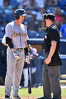 Charleston RiverDogs second baseman Kyle Holder (4) discusses a call  with home plate umpire Sam Burch during a game against the Asheville Tourists at McCormick Field on July 10, 2016 in Asheville, North Carolina. The Tourists defeated the RiverDogs 4-2. (Tony Farlow/Four Seam Images)