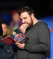 Burnley fan reads over the match day program <br /> <br /> Photographer Ashley Crowden/CameraSport<br /> <br /> The Premier League - Crystal Palace v Burnley - Saturday 13th January 2018 - Selhurst Park - London<br /> <br /> World Copyright &copy; 2018 CameraSport. All rights reserved. 43 Linden Ave. Countesthorpe. Leicester. England. LE8 5PG - Tel: +44 (0) 116 277 4147 - admin@camerasport.com - www.camerasport.com
