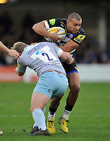 Jonathan Joseph of Bath Rugby is tackled by Mike Haywood of Northampton Saints. Aviva Premiership match, between Bath Rugby and Northampton Saints on December 5, 2015 at the Recreation Ground in Bath, England. Photo by: Patrick Khachfe / Onside Images