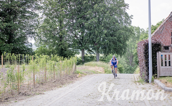 up the infamous Koppenberg in Oudenaarde<br /> <br /> cycling hotspots & impressions in the Vlaamse Ardennen (Flemish Ardennes) along the 181km Spartacus (Chasing Cancellara) cycling route<br /> <br /> Cycling In Flanders <br /> Flanders Tourist Board<br /> <br /> ©kramon