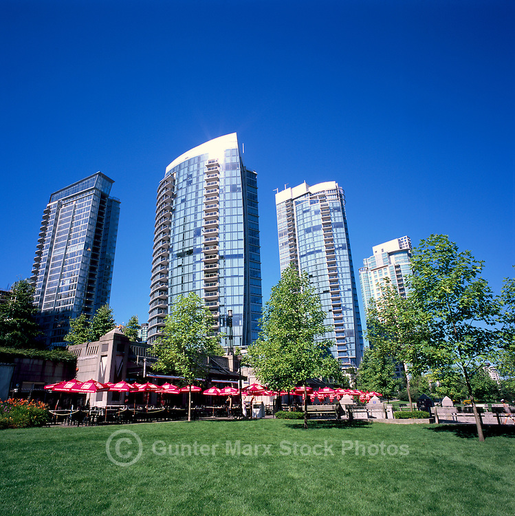 "The Mill Marine Bistro - an Outdoor Restaurant Cafe with Red Sun Umbrellas, in front of Condominium Highrise Buildings along Waterfront at ""Coal Harbour"", in the ""West End"" of Vancouver, British Columbia, Canada, in Summer."