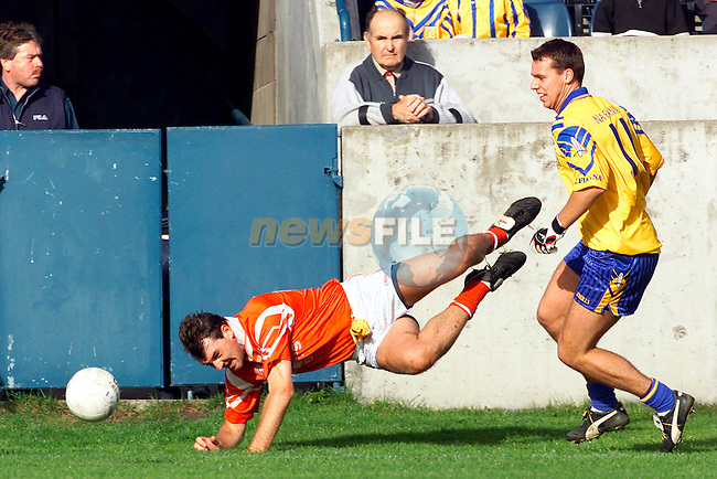 Na Fianna's Nigel Clancy in action against St. Brigids Colin McGlynn in the Dublin Senior Football Championship Final at Parnell Park..Picture: Paul Mohan/Newsfile