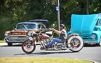 NWA Democrat-Gazette/MICHAEL WOODS &bull; @NWAMICHAELW<br /> Darrel Buford from Pryor Oklahoma, rides his custom built rat bike past the cars on display at the 4th Annual Car/Truck Show Friday September 25, 2015 at Arvest Ballpark in Springdale.  The Car show continues Saturday with trophies given out for over 27 different categories including Best of Show, Engine, Paint, Upholstery, Undercarriage &amp; Longest Distance. The 16th annual Bikes, Blues and BBQ Motorcycle Rally runs through Saturday on Dickson Street, Baum Stadium and the Washington County Fairgrounds in Fayetteville and all day Saturday at Arvest Ballpark in Springdale.