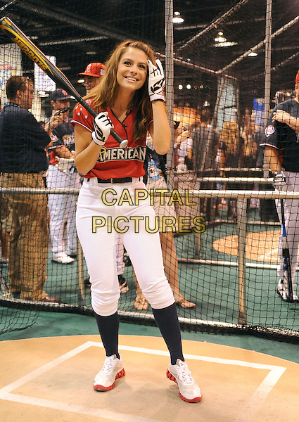 MARIA MENOUNOS.At the MLB All Star Fanfest Batting Practice held at The Anaheim Convention Center , the precursor to The All Star Legends Celebrity Softball game in Anaheim, California, USA..July 11th, 2010.full length red black top baseball batting cage bat socks swinging hand glove white trousers  .CAP/RKE/DVS.©DVS/RockinExposures/Capital Pictures.