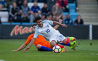 Justin Hoogma (1899 Hoffenheim) of Netherlands brings down Marcus Edwards (Tottenham Hotspur) of England U20 during the International friendly match between England U20 and Netherlands U20 at New Bucks Head, Telford, England on 31 August 2017. Photo by Andy Rowland.