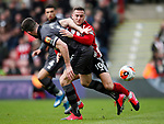 Grant Hanley of Norwich City tussles with Billy Sharp of Sheffield Utd during the Premier League match at Bramall Lane, Sheffield. Picture date: 7th March 2020. Picture credit should read: Simon Bellis/Sportimage