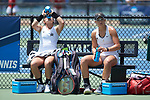 Amanda Meyer (left) and Christina Rosca of the Vanderbilt Commodores take a break during a change-over at #3 doubles against the Stanford Cardinal during the finals of the 2018 NCAA Women's Tennis Championship at the Wake Forest Tennis Center on May 22, 2018 in Winston-Salem, North Carolina. The Cardinal defeated the Commodores 4-3. (Brian Westerholt/Sports On Film)