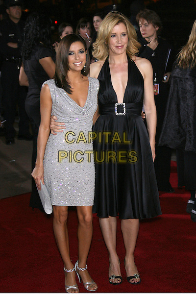 EVA LONGORIA & FELICITY HUFFMAN.The 33rd Annual People's Choice Awards - Arrivals held at The Shrine Auditorium, Los Angeles, California, USA,.9 January 2007. .full length grey silver dress black dress halterneck plunging neckline.CAP/ADM/ZL.©Zach Lipp/AdMedia/Capital Pictures.