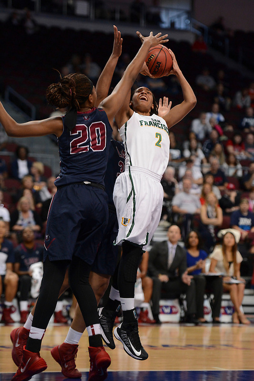 March 6, 2014; Las Vegas, NV, USA; San Francisco Lady Dons guard Taj Winston (2) shoots the ball against Loyola Marymount Lions guard/forward Sophie Taylor (20) during the first half of the WCC Basketball Championships at Orleans Arena.