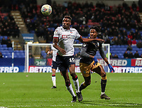 Bolton Wanderers' Sammy Ameobi competing with Sheffield Wednesday's Rolando Aarons <br /> <br /> Photographer Andrew Kearns/CameraSport<br /> <br /> The EFL Sky Bet Championship - Bolton Wanderers v Sheffield Wednesday - Tuesday 12th March 2019 - University of Bolton Stadium - Bolton<br /> <br /> World Copyright © 2019 CameraSport. All rights reserved. 43 Linden Ave. Countesthorpe. Leicester. England. LE8 5PG - Tel: +44 (0) 116 277 4147 - admin@camerasport.com - www.camerasport.com