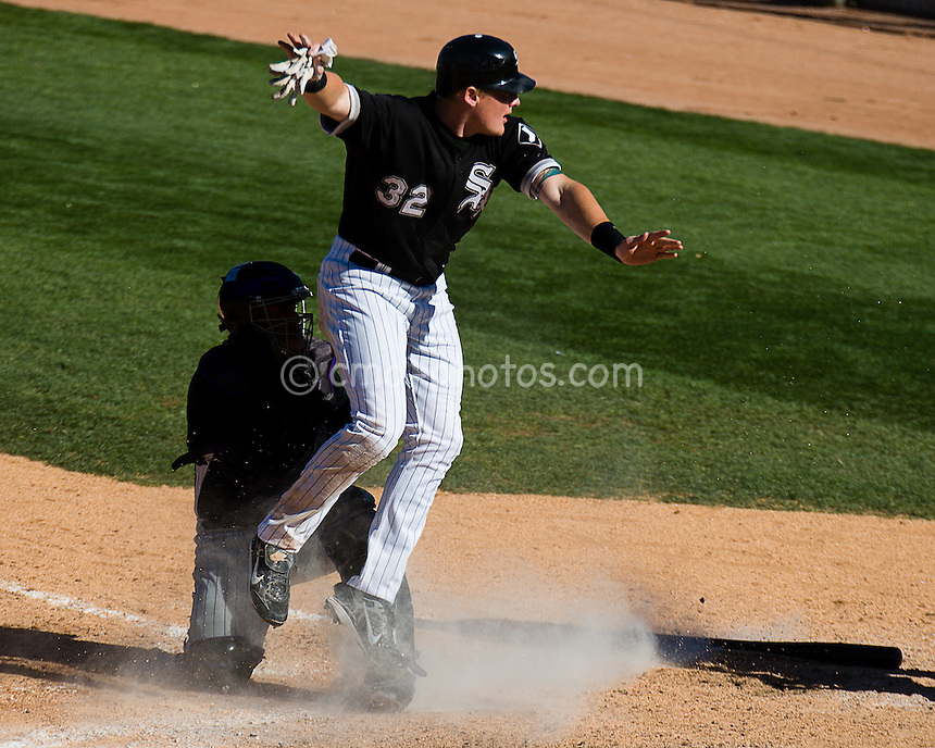 Mar 19, 2008; Tucson, AZ, USA; Chicago White Sox center fielder Brian Anderson (32) gestures to the umpire upon scoring a run in the bottom of the 8th inning during a game against the Colorado Rockies at Tucson Electric Park.  The game ended in a 10-10 tie.