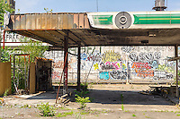 A closed gas station waiting for development in Long Island City in the borough of Queens in New York on Sunday, June 26, 2016. According to a number of surveys Queens, particularly Western Queens with its proximity to Midtown Manhattan, is poised to become the next trendy location, supplanting Brooklyn. (© Richard B. Levine)