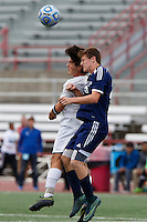 Mishawaka Marian's Christian Juarez, left, and Providence's Alex Rogers (25) play the ball during the IHSAA Class A Boys Soccer State Championship Game on Saturday, Oct. 29, 2016, at Carroll Stadium in Indianapolis. Marian won 4-0. Special to the Tribune/JAMES BROSHER