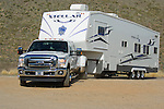 2011 Ford towing fifth wheel trailer.