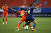 Cleveland, Ohio - Tuesday June 12, 2018: Lou Jiahui, Carli Lloyd during an international friendly match between the women's national teams of the United States (USA) and China PR (CHN) at FirstEnergy Stadium.