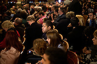 The audience waits for former Massachusetts governor Mitt Romney to arrive and speak town hall meeting and rally at the Rochester Opera House in Rochester, New Hampshire, on Jan. 8, 2012. Romney is seeking the 2012 Republican presidential nomination.