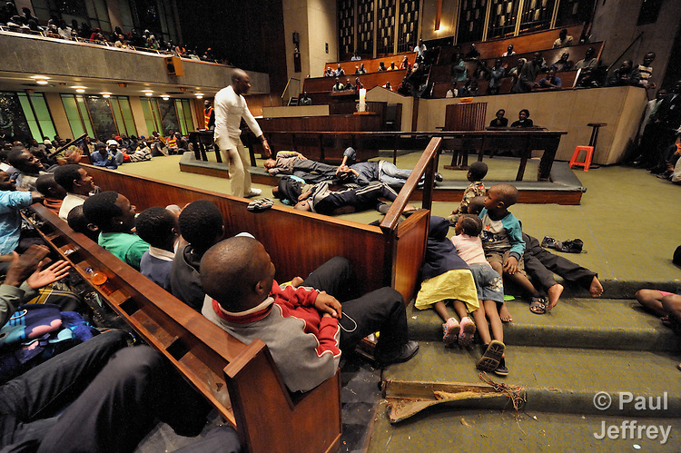 Refugees from Zimbabwe and other African countries perform an educational skit during evening worship the Central Methodist Church in Johannesburg, South Africa. The church is home to more than 3,000 refugees suffering from economic desperation and sporadic xenophobic attacks. The skits cover themes ranging from HIV and AIDS to violence against women to conflict resolution among people living in the church.