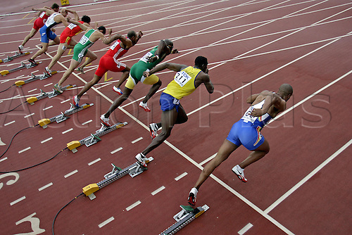 10 August 2005:  Elevated view of sprinters leaving the starting blocks in the second heat in the Mens 110m Hurdles at the IAAF World Athletics Championships, held in the Olympic Stadium, Helsinki, Finland Photo: Glyn Kirk/actionplus...050810  man men athlete male runner sprint