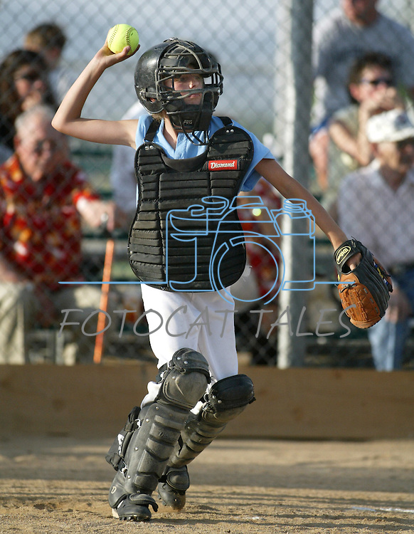 Recreational softball action in Gardnerville, Nev., on June 16, 2003..Photo by Cathleen Allison